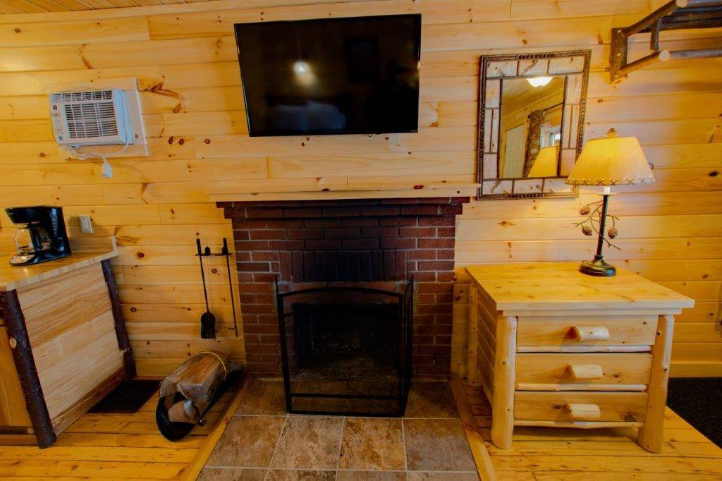 Cabin 6 has a wood burning fireplace