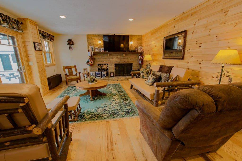 Livingroom with wood burning fireplace
